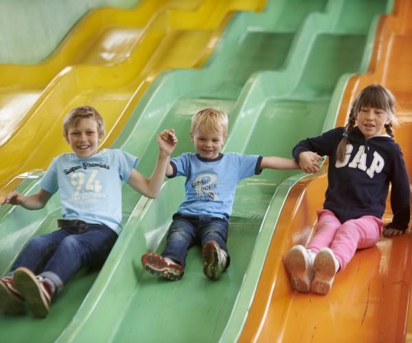 Children take on the six-lane Mega Slide at Cornwall's Crealy near Wadebridge.